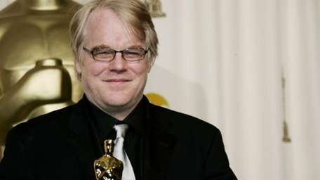 Actor Philip Seymour Hoffman poses with the best