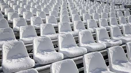 The seats are covered with snow on Sunday,