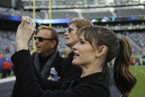 Actress Jennifer Garner takes a photo as actors