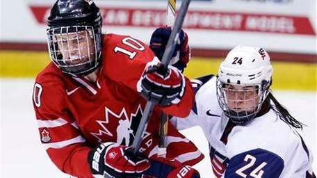 Canada's Gillian Apps (10) and United States' Josephine