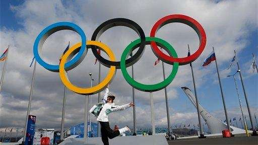 A woman jumps as she poses for a