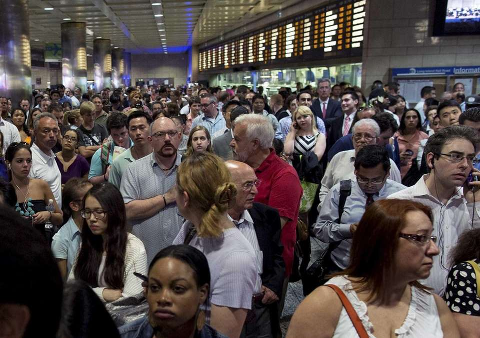 Hundreds of passengers wait at Penn Station after
