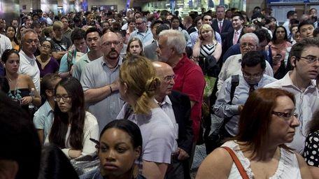 Hundreds of passengers wait at Penn Station after