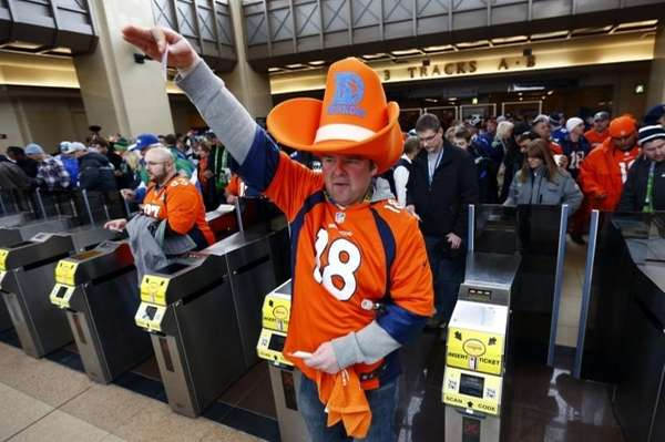 Football fans enter the Secaucus Junction on Feb.