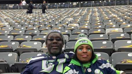 Bessie Lee, mother of Bruce Irvin, sits with