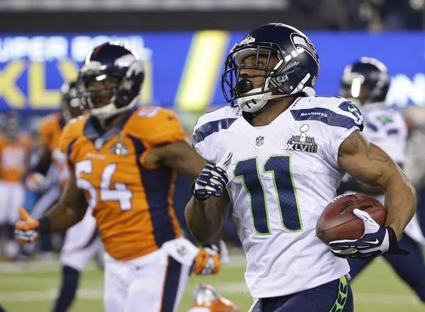 Seattle Seahawks' Percy Harvin returns a kickoff 87-yards