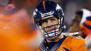 Broncos' Peyton Manning looks at the scoreboard during