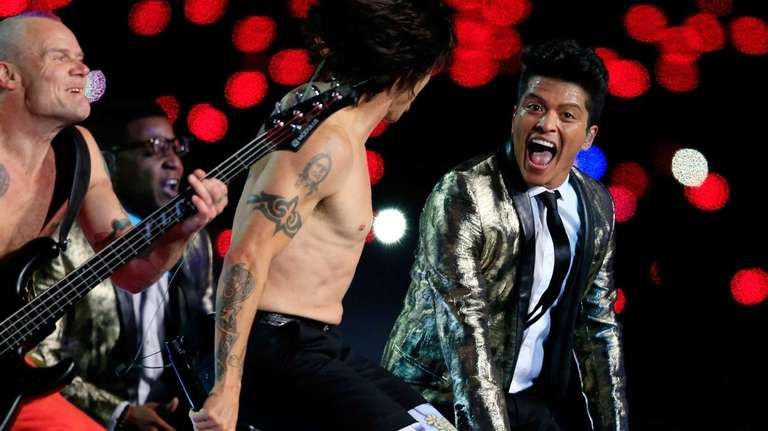 Bruno Mars performs with Anthony Kiedis and Flea