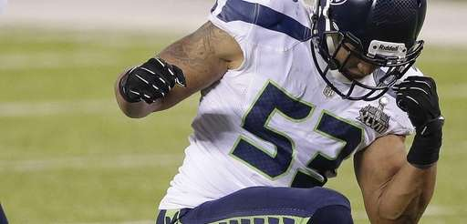 Seattle Seahawks outside linebacker Malcolm Smith (53) reacts