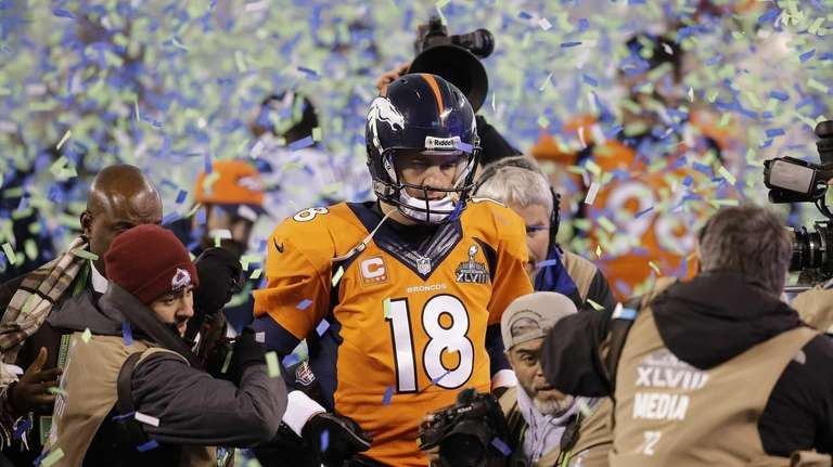 Broncos quarterback Peyton Manning walks off the field