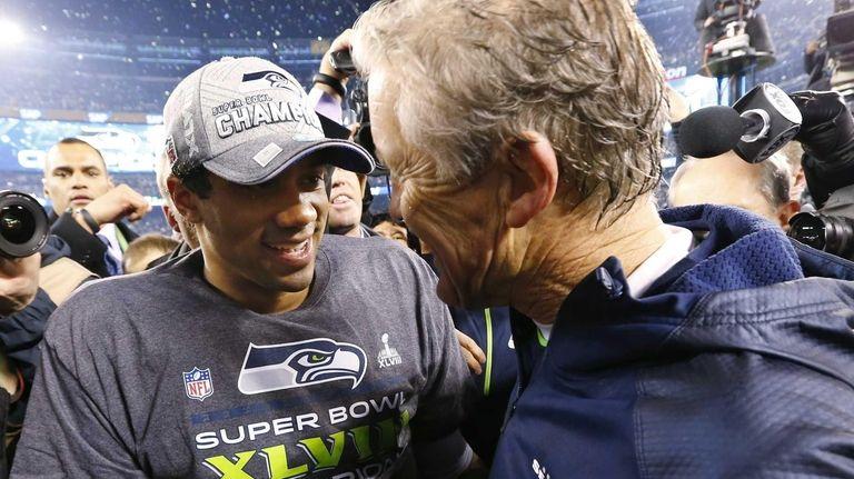 Seattle Seahawks head coach Pete Carroll, right, celebrates