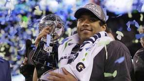 Seattle Seahawks' quarterback Russell Wilson holds the Lombardi