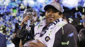 Seattle Seahawks' quarterback Russell Wilson holds the Lombardi