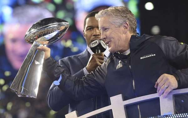 Seattle Seahawks coach Pete Carroll lifts the Lombardi