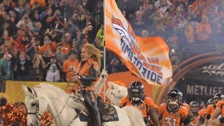 The Denver Broncos enter the field at Super