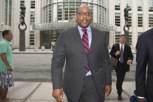New York State Senator John Sampson, center, exits