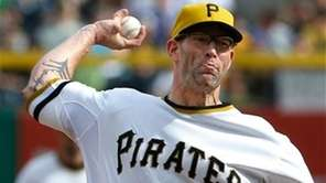 Pittsburgh Pirates relief pitcher Kyle Farnsworth throws against
