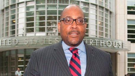 New York State Sen. John Sampson exits the