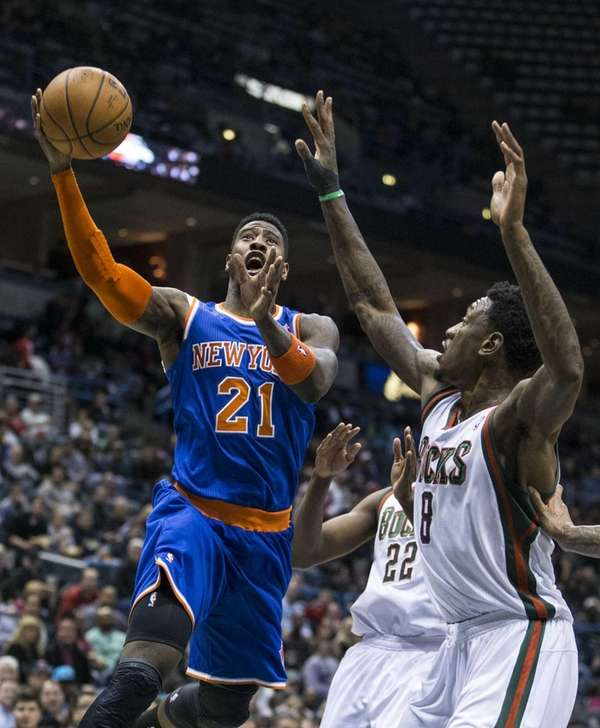 Iman Shumpert drives in for a shot against