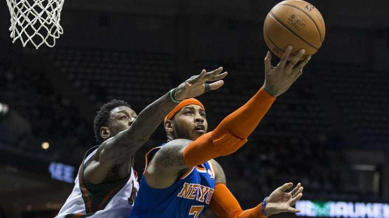 Carmelo Anthony shoots the ball against the Milwaukee