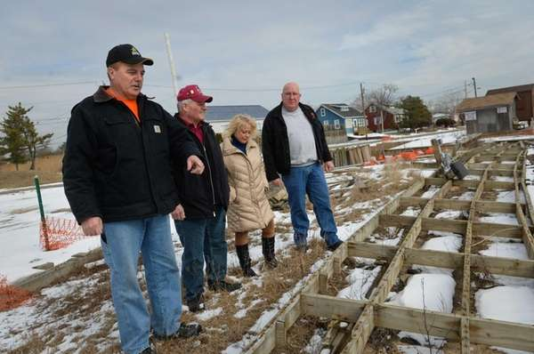 Mayor Bill Biondi, left, stands on the damaged