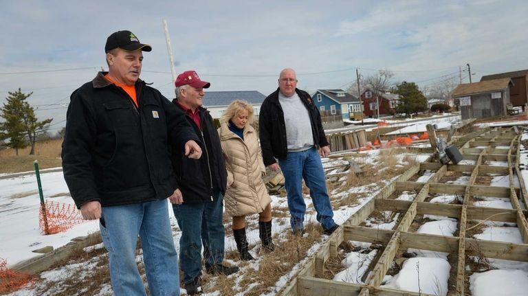 Mayor Bill Biondi, left, stands on the damaged