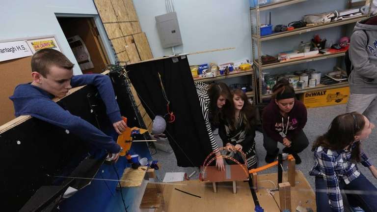 Team members from Wantagh High School work on