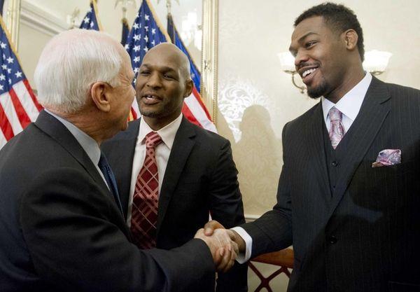 U.S. Sen. John McCain, left, of Arizona greets
