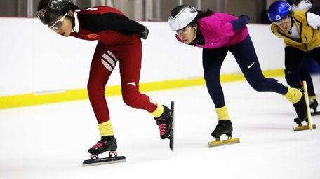 Jacki Munzel, of Long Beach, right, skates with