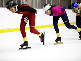 Jacki Munzel, of Long Beach, right, skates with