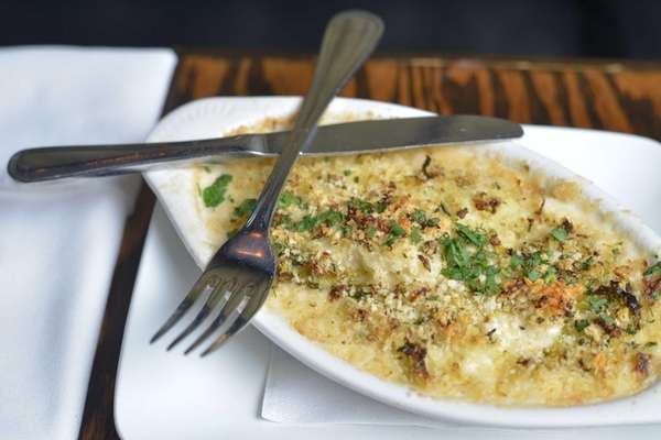 Baked cauliflower with crisp pork belly, aged Cheddar,