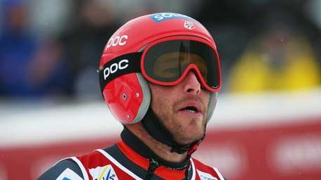 Bode Miller stands in the finish area after