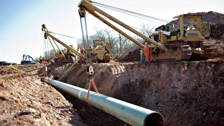 A sixty-foot section of pipe is lowered into