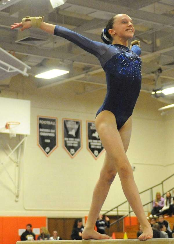 Miranda Lund of Plainview-JFK performs her routine on
