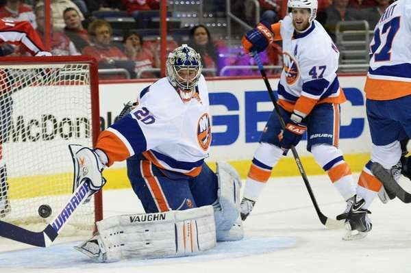 Evgeni Nabokov of the Islanders makes a save