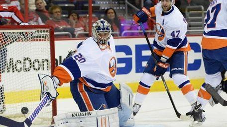 Evgeni Nabokov of the Islanders makes a save