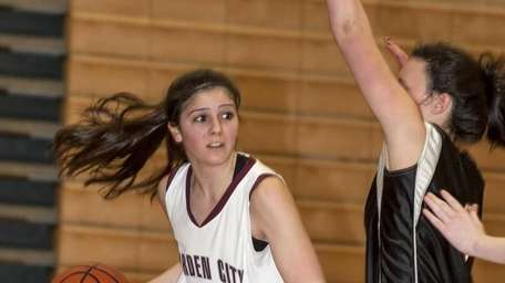 Garden City's Samantha Auricchio, left, looks to get