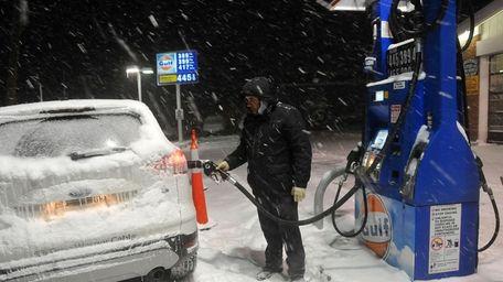 Singh Mann pumps gas for a Gulf station