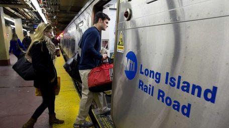 LIRR customers board a train at Penn Station