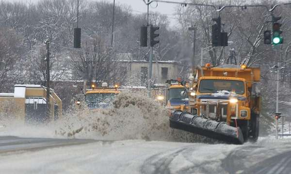 Plows clear the snow on Route 25 in