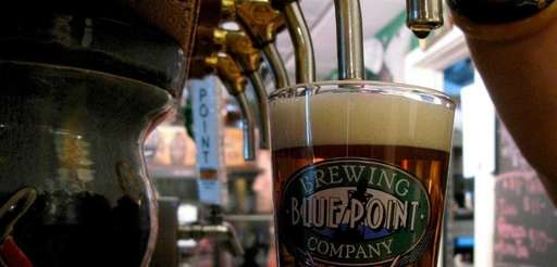 A pint of craft beer is tapped at