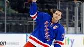 Ryan Callahan salutes the crowd after he was