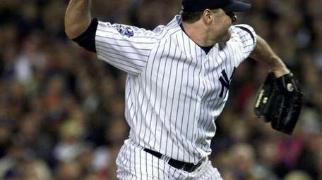 Former Yankees pitcher Roger Clemens throws the broken