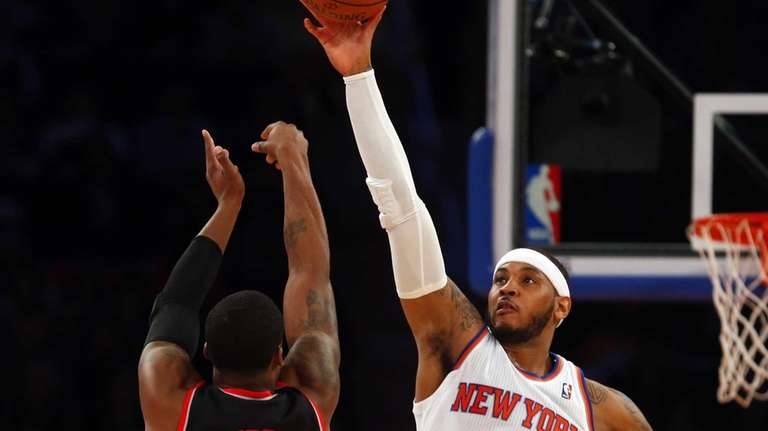 Carmelo Anthony blocks a shot in the second