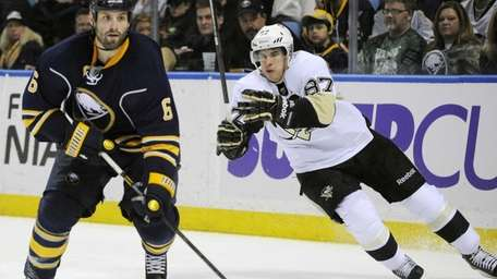 Sabres' Mike Weber heads up ice as Penguins'
