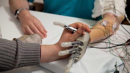 A sensory feedback enabled prosthetic hand goes through