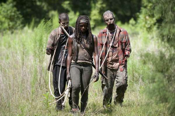 Walkers and Michonne (Danai Gurira) in