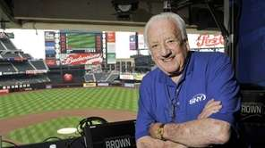 Ralph Kiner in the broadcast booth before a