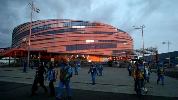 Volunteers exit Shayba Arena ahead of the Sochi