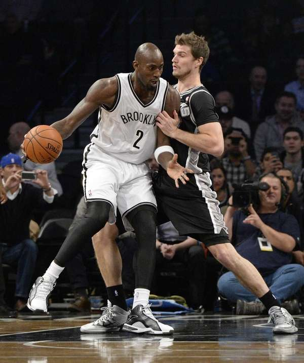 Brooklyn Nets forward Kevin Garnett is defended by